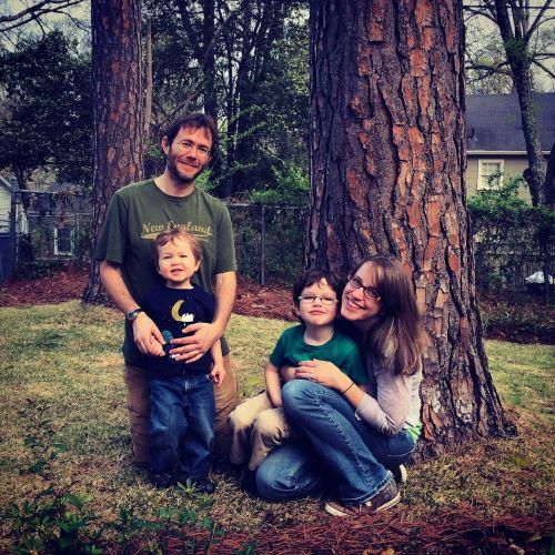 Family portrait under the pine tree