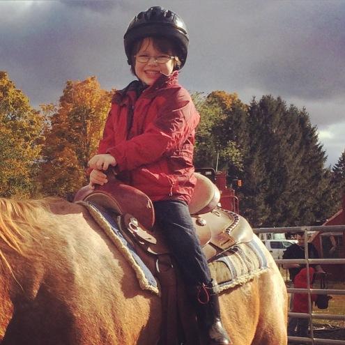 happy boy on a horse