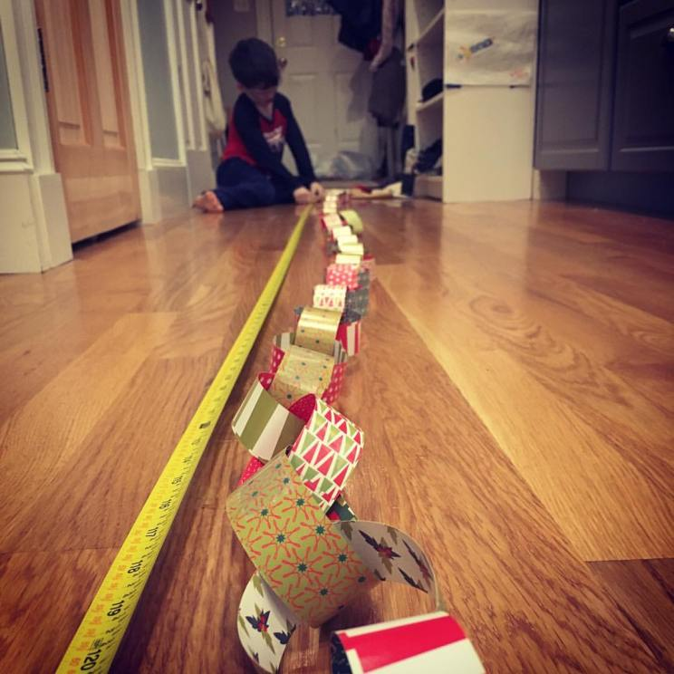 kids measuring, paper chain, christmas crafts